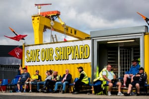 Employees of Harland and Wolff during their protest at the gates of the shipyard in Belfast, waiting to hear if there will be a last minute deal to keep the business from closing, as it is set to go into administration later.
