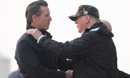 Donald Trump greets Gavin Newsom at Beale air force base in California while traveling to view wildfire damage in November.