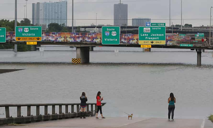 People view the flooded highways in Houston as the city battles with tropical storm Harvey and resulting floods.