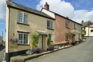 Stone cottages in pastel shades in the small Devon village of Winkleigh
