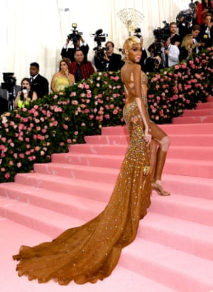 Winnie Harlow sports a blond cropped wig and jewelled full-length gown