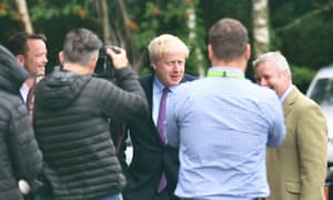 Boris Johnson arrives at the offices of the BVG Group in Brecon during his visit to Wales.