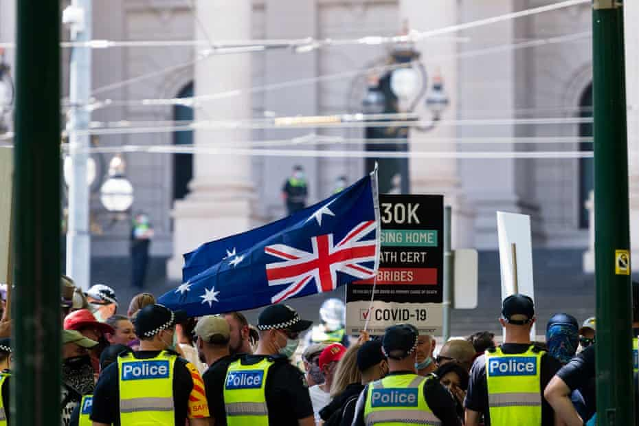 The Australian flag being flown upside down during the Melbourne Freedom Rally at Parliament House in a bid to see the resignation of the Victorian Premier Daniel Andrews.