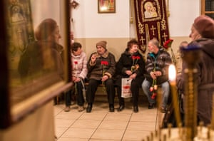 People attend a commemoration of the 30th anniversary of the Chernobyl nuclear disaster at St Michael the Archangel Orthodox church in Kiev