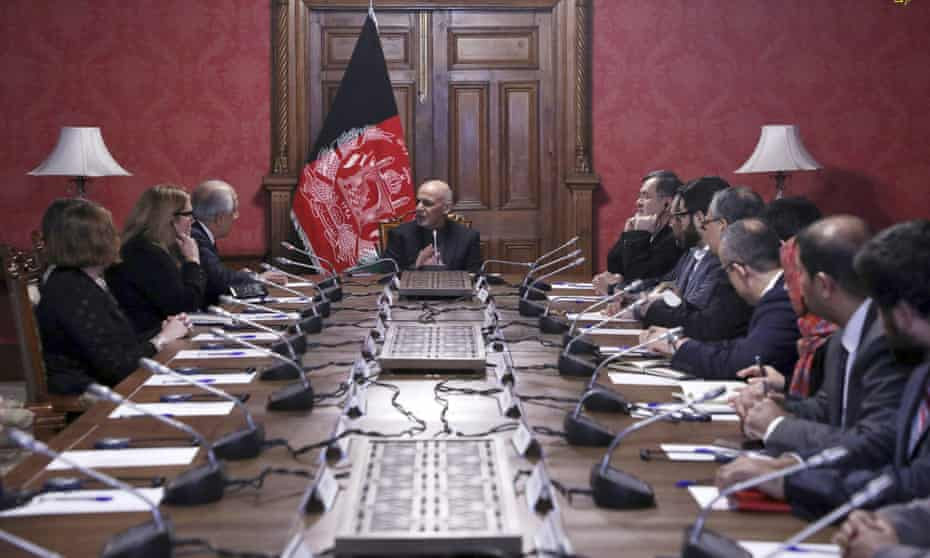 President Ashraf Ghani speaks to the US peace envoy Zalmay Khalilzad, third from left, at the presidential palace in Kabul.