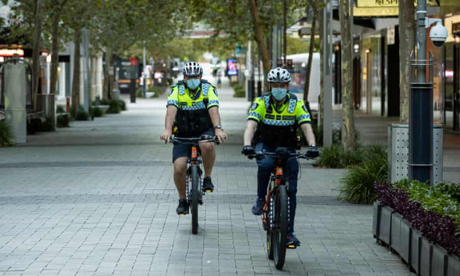 Police patrol the Perth CDB an hour into the lockdown on Sunday evening.
