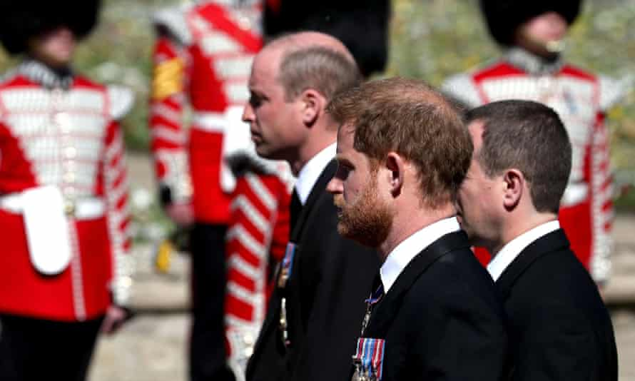 Princes William and Harry follow the Duke of Edinburgh's coffin through the parade ground