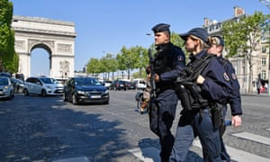 Armed police on the Champs-Elysées the day after the shooting.