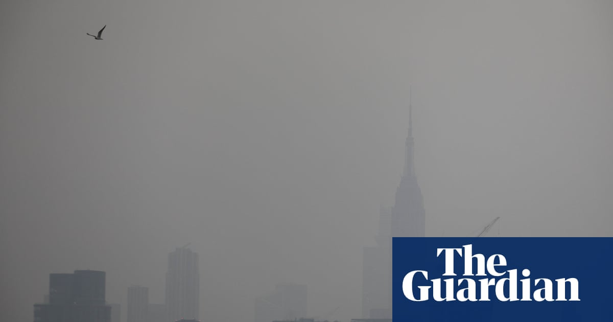 Aerial shots of New York show hazy skies from western US wildfires – video