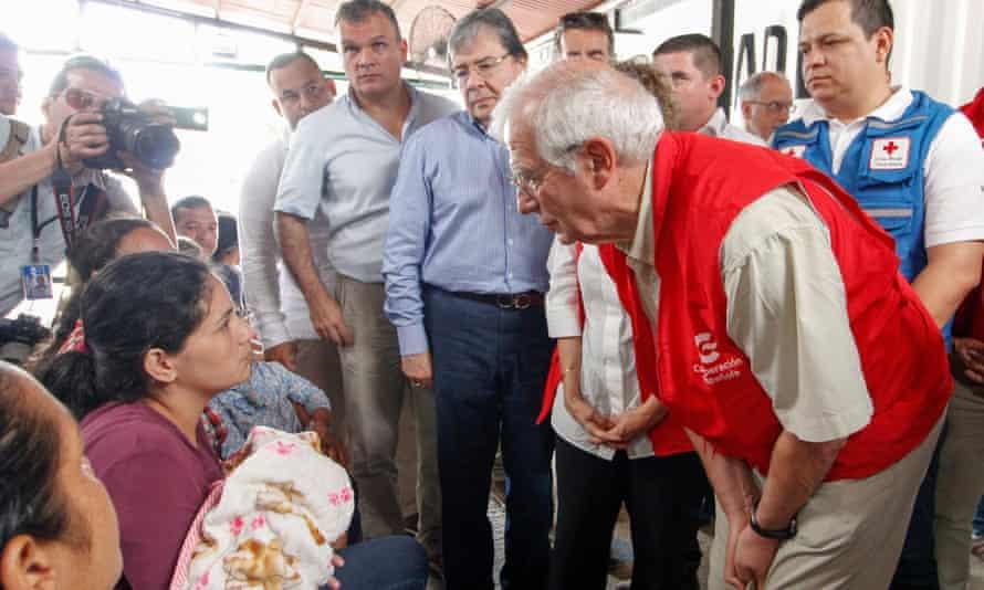 Borrell talks to Venezuelan migrants during a visit to the Simon Bolivar international bridge at the border of Colombia and Venezuela