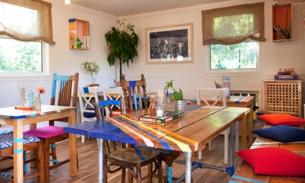 Mismatching, painted wooden chairs and tables in the dining room at the Humble Bee Cafe
