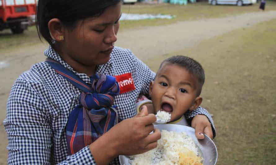 An ethnic Kachin woman feeds her child in compound of Trinity Baptist church camp for internally displaced people in Myitkyina.