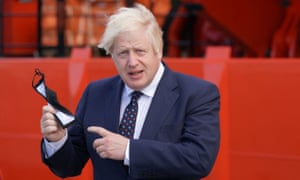 Britain's prime minister Boris Johnson holds his face mask before boarding the vessel Alba at Fraserburgh Harbour, Aberdeenshire on August 5, 2021. Photo by Jane Barlow / POOL / AFP