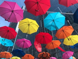 Shenyang, China: hundreds of colourful umbrellas are seen in the street, as temperatures reach 34C (93.2F)