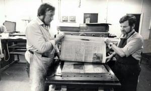 Guardian print staff creating a flong (a page impression made on thick paper) from a finished type set page, 1983. Once a page had been set and corrected it would be covered with a thick sheet of paper (known as a flong) and an impression taken under immense pressure. From the flong a curved metal plate (known as a stereotype plate) would be moulded by the stereo department.  (Archive ref: GUA/6/9/1/4/G box 3)