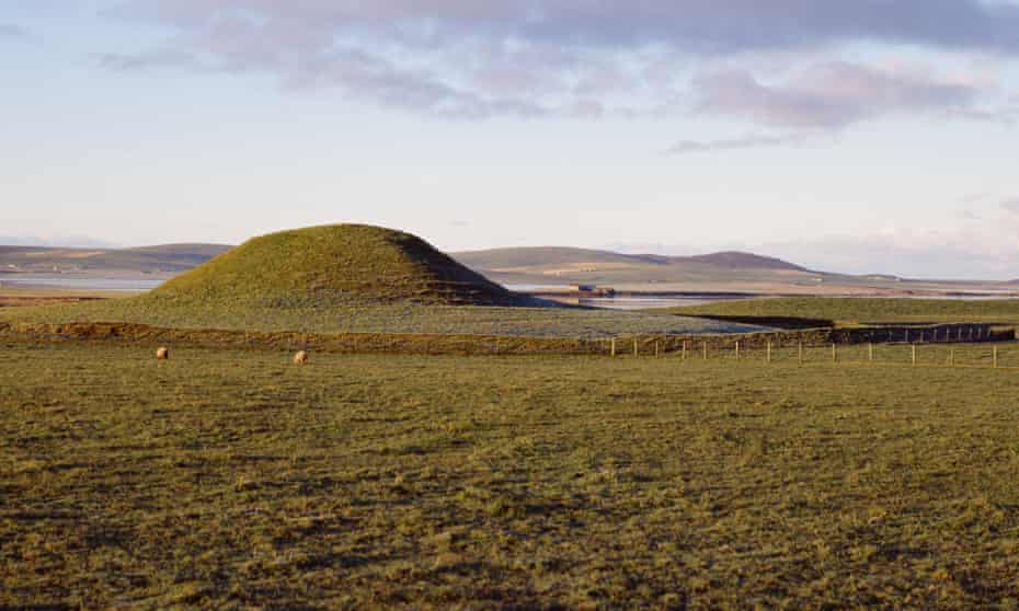 The Maeshowe neolithic burial mound tomb and Loch of Harray, Orkney.