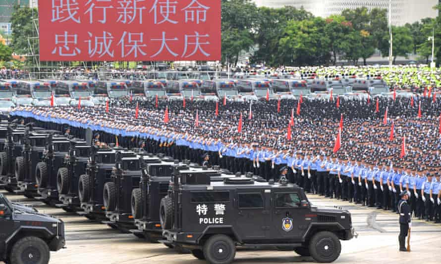 Chinese police officers take part in anti-riot drills in Shenzhen in China's southern Guangdong province. The US has compared China to a 'thuggish regime'.