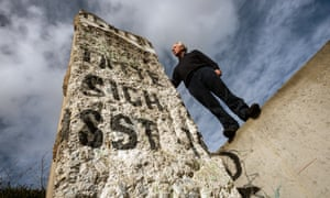 James Rylands, of Summers Place Auctions, with one of the sections of the Berlin Wall up for sale next week