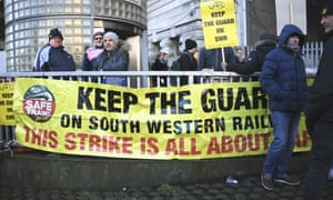 RMT, Rail, Maritime and Transport Union workers protest outside Waterloo.