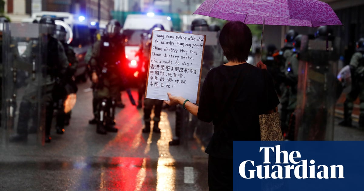 Hong Kong protesters take to streets in triad district after clashes