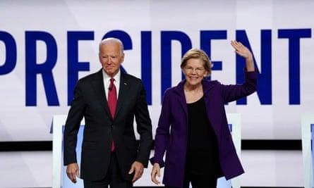 Joe Biden andElizabeth Warren pose together in October