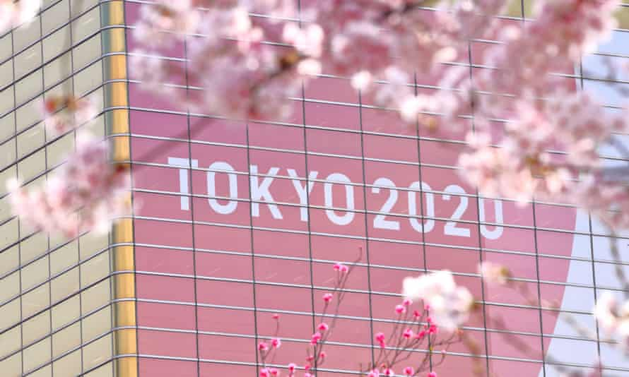 A banner for Tokyo 2020 on display in Asakusa. Coronavirus means the Games will take place next year, with a spring 'Cherry Blossom Games' one suggested alternative.