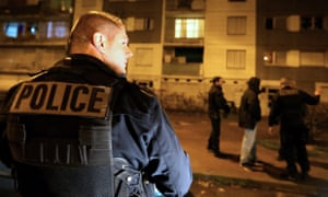 Police enforce a curfew at a housing project in the Champs Plaisants district of Sens, south-east of Paris
