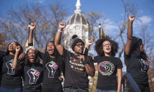 Students at the university of Missouri protest against the campus's racist culture.