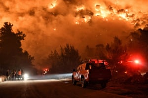 Schinos, GreeceFlames rise as firefighters and volunteers try to extinguish a fire burning in the village near Corinth in May