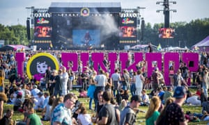 Festival goers gather during the first day of the music festival Pinkpop, at Landgraaf. A bus struck four people in the early hours of Monday, killing one and injuring three, police said.
