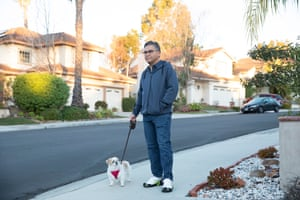 Kia Nasseri, who lives in Rancho Santa Margarita, California, walks his stepdaughter's dog, Nikki. Although his wife has a green card, they have not been able to get approval for their daughter to join them.