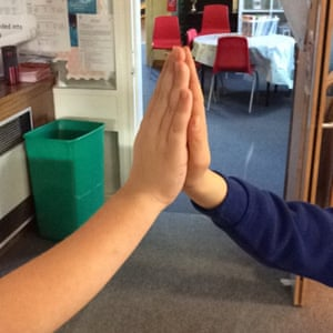 High-fiving my school partner by Harry, nine