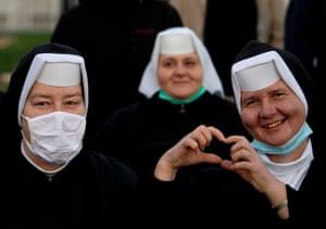 Nuns smile for the camera as they wait for Pope Francis in Šaštin-Stráže, Slovakia