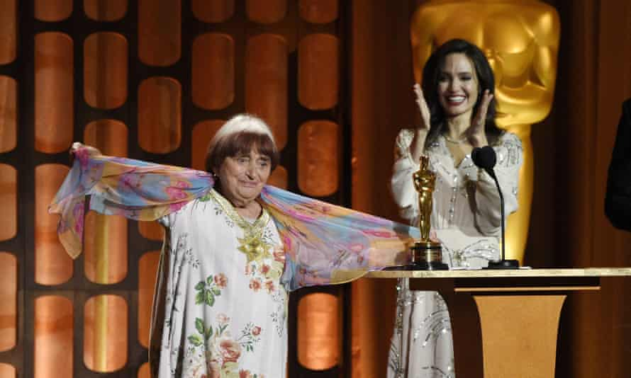 Agnes Varda accepted an honorary Oscar in 2017 as presenter Angelina Jolie looked on.