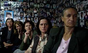 Bosnian Muslim women from Srebrenica watch a televised broadcast of former Bosnian Serb military chief Ratko Mladic's court proceedings at The Hague