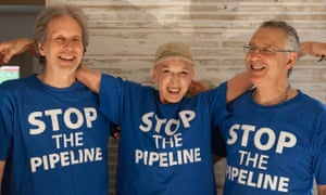 Thom Krystofiak, left, Inga Frick and Jonas Magram, climate change campaigners from Fairfield, Iowa, who were arrested at a protest in Whiting, Indiana, on 15 May 2016.
