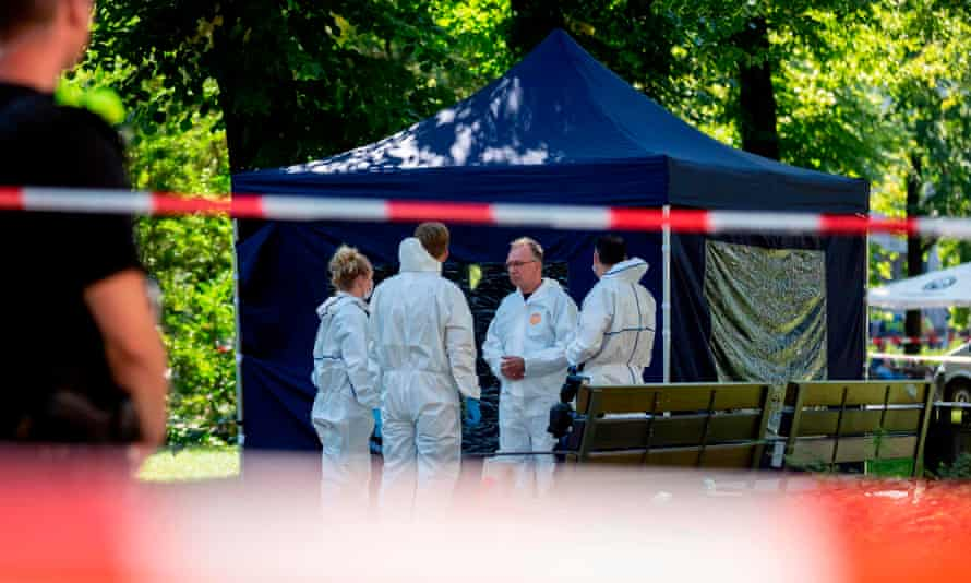 Forensic experts at the park where Zelimkhan Khangoshvili was shot dead.