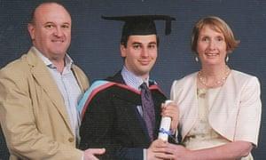Elliott Johnson at his graduation with his parents.
