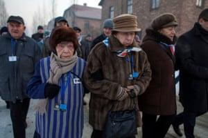 Survivors walk through the camp