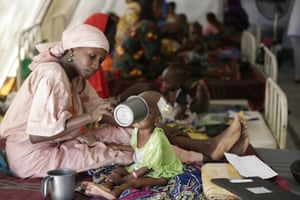 A mother feeds her malnourished child at a nutrition clinic run by Médicins Sans Frontières in Maiduguri