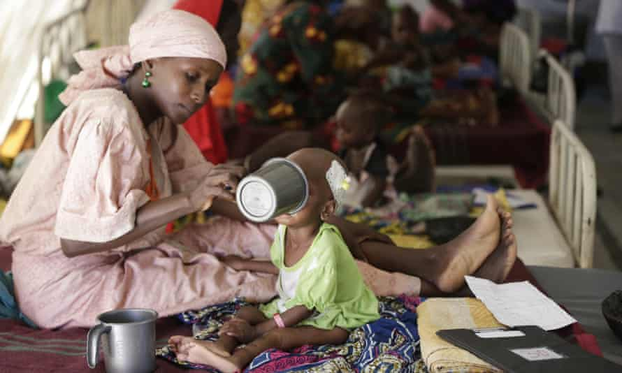 A mother feeds her malnourished child at clinic run by Médecins Sans Frontières in Maiduguri.