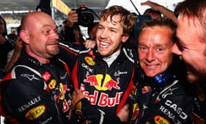 Sebastian Vettel celebrates with teammates in the Red Bull garage as he clinches the drivers world championship for the third time.