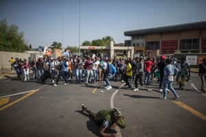 Students from the University of Johannesburg demonstrate outside the Soweto campus during the #feesmustfall protests