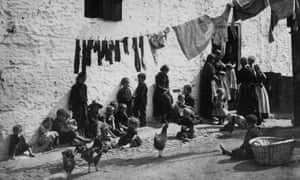 Washing day in a slum area of London, 1889.