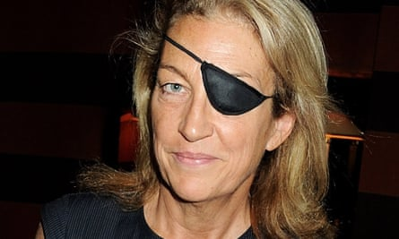 Marie Colvin smiling in evening dress and with black eye patch