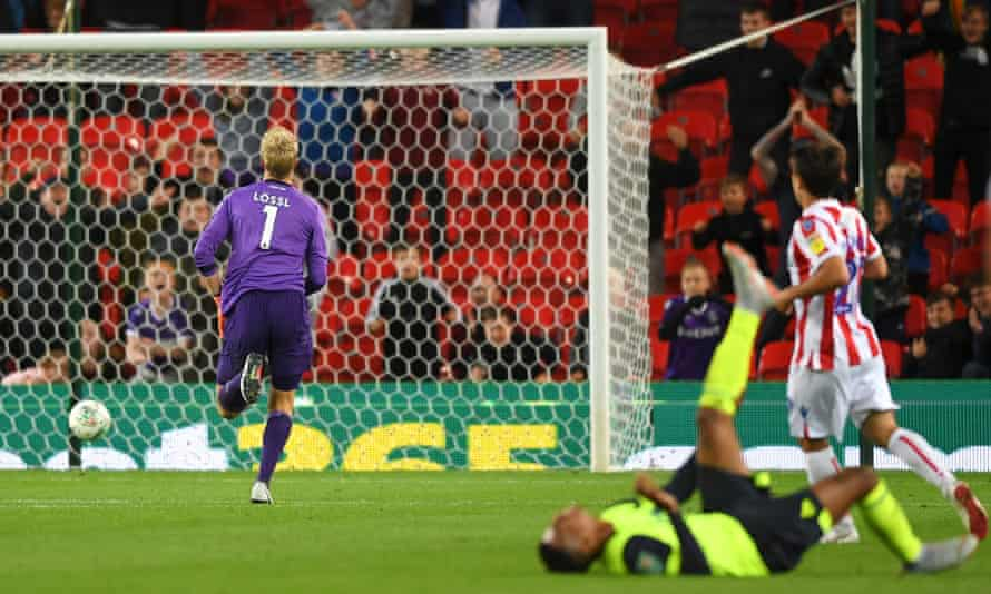 Jonas Lössl of Huddersfield Town runs in vain towards his goal after Juninho Bacuna scored a long-range own goal at Stoke in 2018.