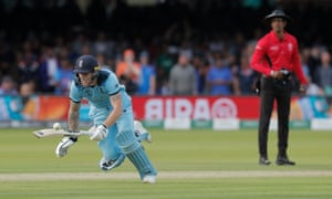 Ben Stokes dives to make his ground but the ball deflects off his bat for four overthrows.