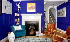 The living room, with blue walls, in Kellie and Will's home