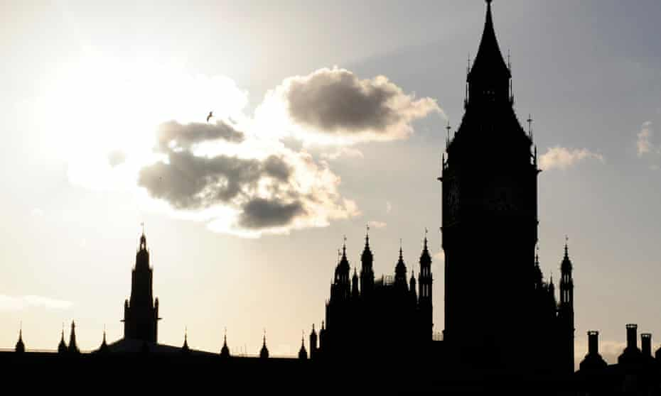 The sun sets behind the House of Commons in Westminster.