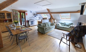 Living and dining area of The Tollant cottage near Rhayader, Powys, Wales